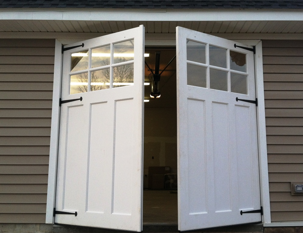 Carriage doors signature carriage wood garage doors for 2 door garage door