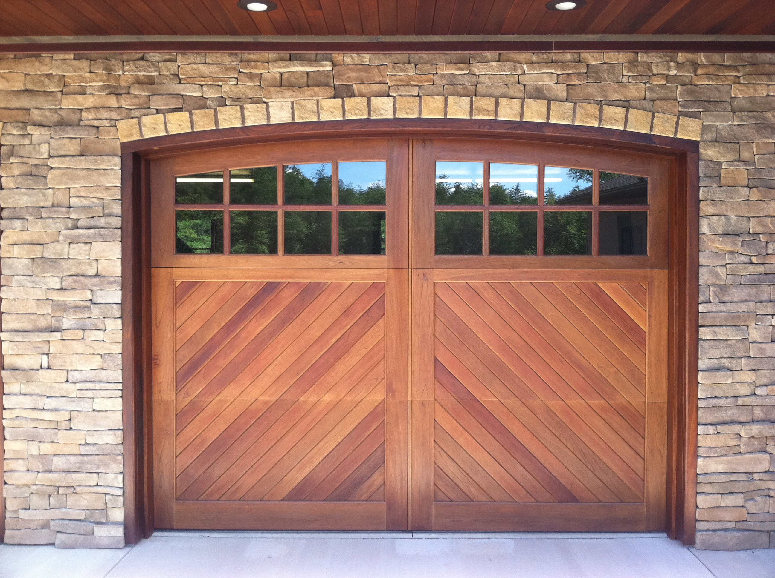 Wood garage doors and carriage doors clearville for 16 x 10 garage door cost
