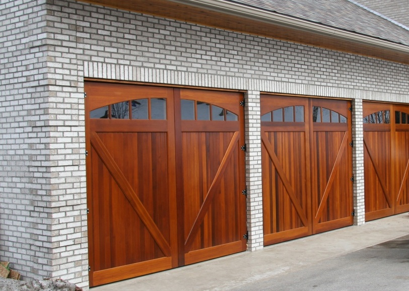 Wood garage doors and carriage doors clearville for 2 door garage door